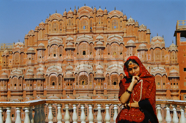 ca. 1799, Jaipur, India --- Woman Visiting the Hawa Mahal --- Image by © Free Agents Limited/CORBIS